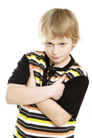 A studio shot of little angry boy photo