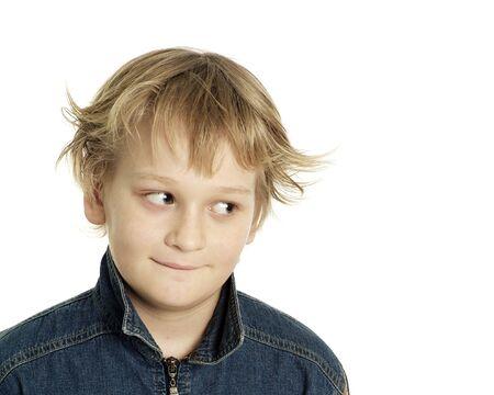 Making faces little boy on a white background Standard-Bild