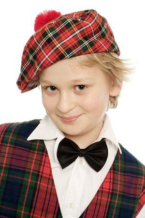 Good looking little stotsman on white background Stock Photo