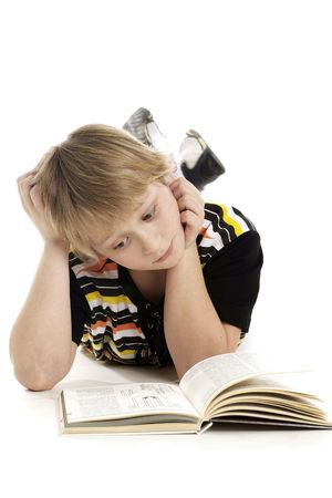 Young reading boy on a white background
