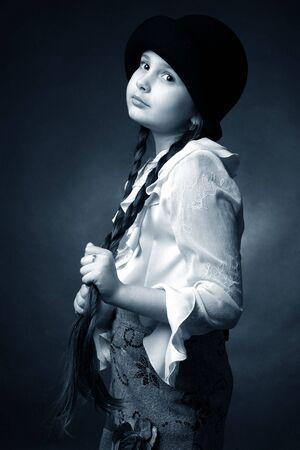 Retro studio portrait of little pretty girl photo