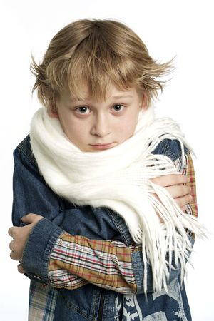 A photo of affected by cold little boy