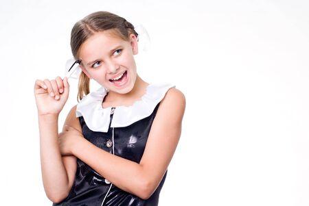 Funny pretty schoolgirl with pen scratching head Standard-Bild