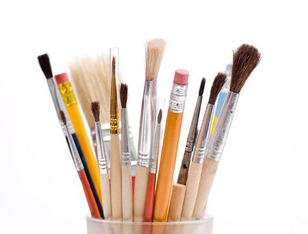 coloured pencil: Pencils and brushes closeup at white background Stock Photo