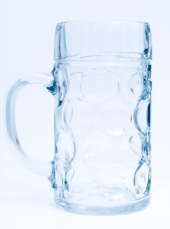bar ware: Empty transparent beer goblet at white background