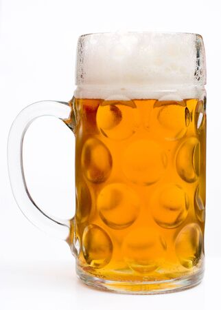 Mug full of beer at white background photo