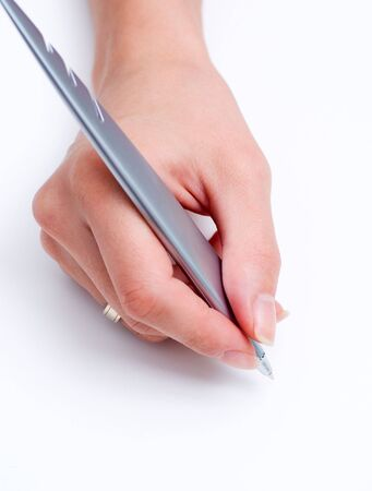Grey pen in female hand at white background