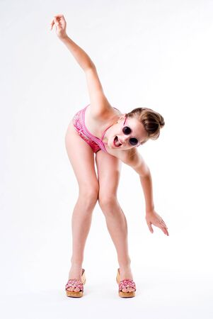 legs open: Expressive young flying girl posing mouth open