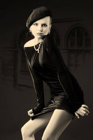 Beautiful young retro lady in black standing in alluring pose
