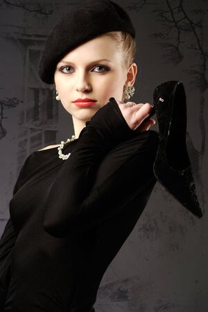 Beautiful young retro lady in black studio portrait