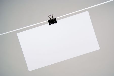 business metaphore: Sheet of paper for notes hanging on rope