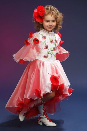 Beautiful little princess in dress studio shot portrait