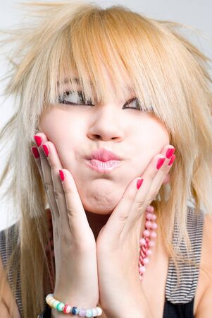 Emo girl blowing cheeks Stock Photo - 3744210