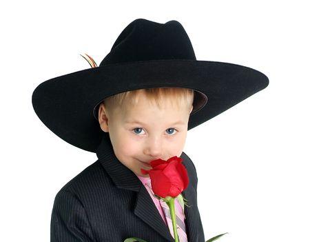 Ni�o oliendo una rosa de cerca retrato Foto de archivo - 4279634