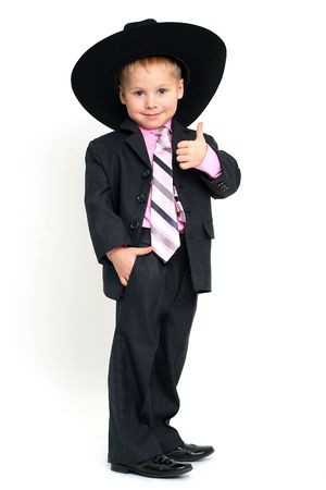 Little smiling boy in big hat gesturing OK