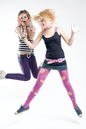 Two expressive jumping punk girls