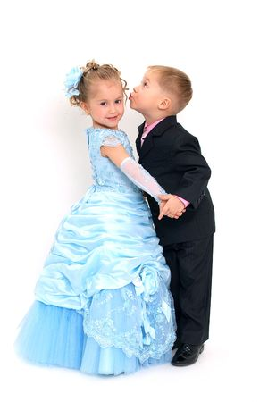 Little pretty boy kisses girl in blue dress