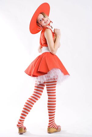 Funny pretty girl in red costume with heart