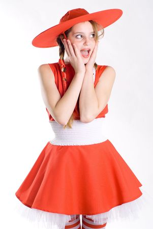 Surprised girl in red hat posing mouth open Stock Photo