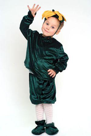 Little grimacing boy in costume studio shot
