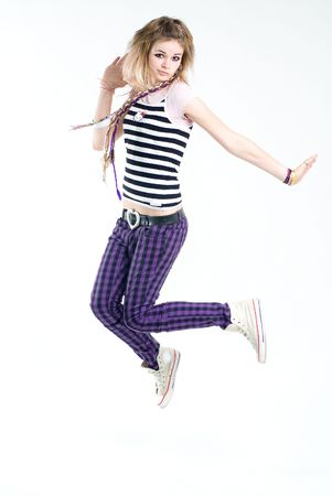 Bizarre jumping teenage trendy girl