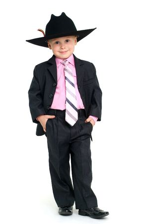 mens: Little handsome boy in elegant suit and hat Stock Photo