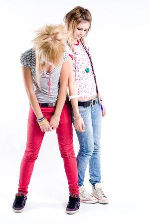 Two teenage standing sad trendy girls photo