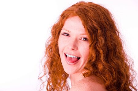 Pretty redheaded girl showing her tongue portrait photo