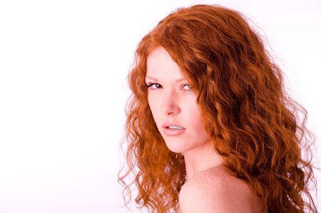 Staring sad glamourous redheaded girl closeup portrait Standard-Bild