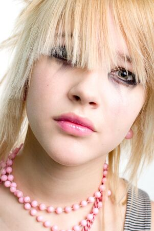 Crying blonde trendy teenage girl closeup portrait photo