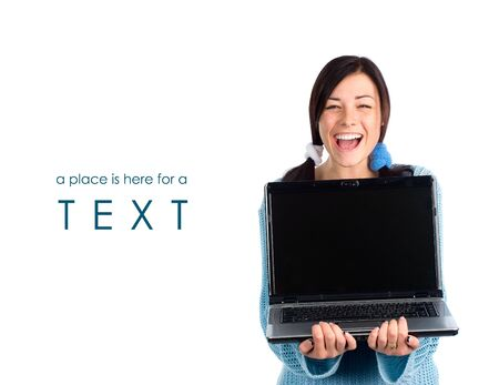 Laughing girl with laptop and a sample of text photo