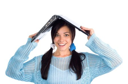 Pretty brunette holding laptop over her head photo