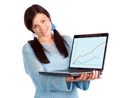 Attraktive Brünette zeigt Laptop mit Grafik Standard-Bild - 5765135