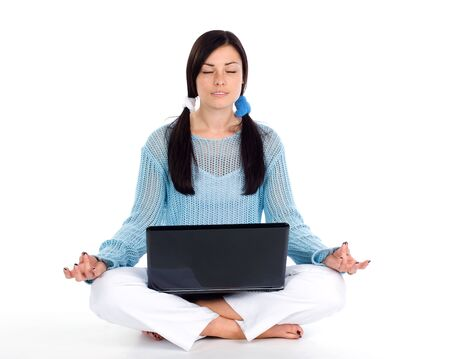 Brunette girl in lotus position with laptop photo
