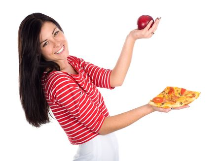 Cute brunette juggles with apple and piece of pizza Standard-Bild