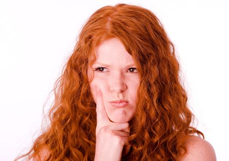 offended: Angry pouting offended girl with red hair. White balance corrected