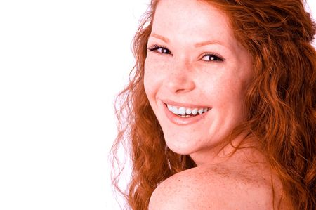 freckles: Cheerful toothy smiling pretty girl with red hair. White balance corrected Stock Photo