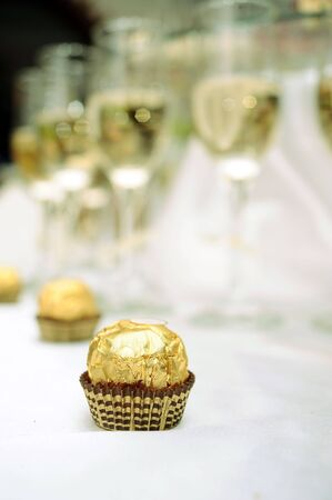 Chocolates and glasses of white wine