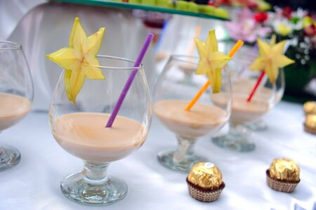 Glasses of cocktail and chocolate candies photo