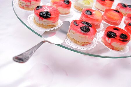 Tasty jelly cakes with blackberries photo