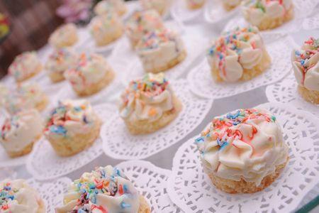 Small vanilla creamy cakes on the table photo