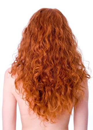 woman back view: Gorgeous curly redhead girls back. White balance corrected Stock Photo