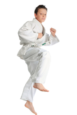 Young boy making karate exercise photo
