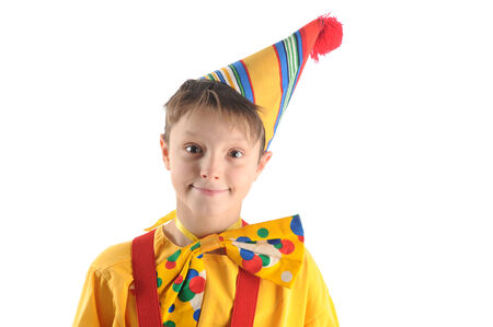 Brightly dressed cheerful smiling clown boy portrait photo