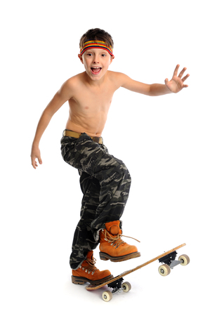 Young expressive handsome boy is skateboarding over white photo