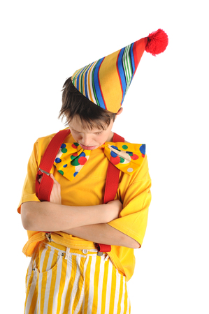 Sulking boy dressed in carnival costume Standard-Bild