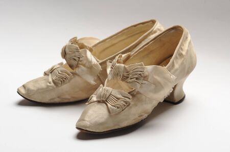 Pair of antique women pretty shoes decorated with bows Standard-Bild