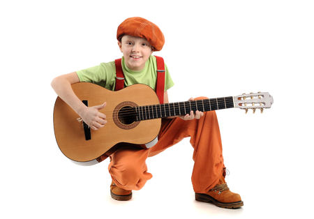 Young handsome smiling boy playing guitar Standard-Bild