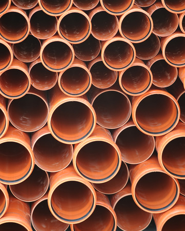 Folded brown industrial tubes circles background Standard-Bild
