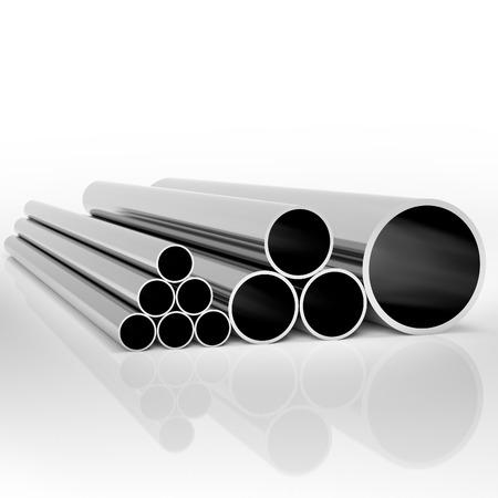 白い背景で異なるサイズの工業用の金属パイプを折り